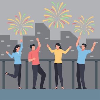 人々は建物の背景と空に祝うと花火