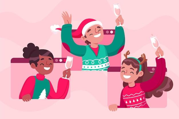 Люди празднуют рождество во время видеозвонка