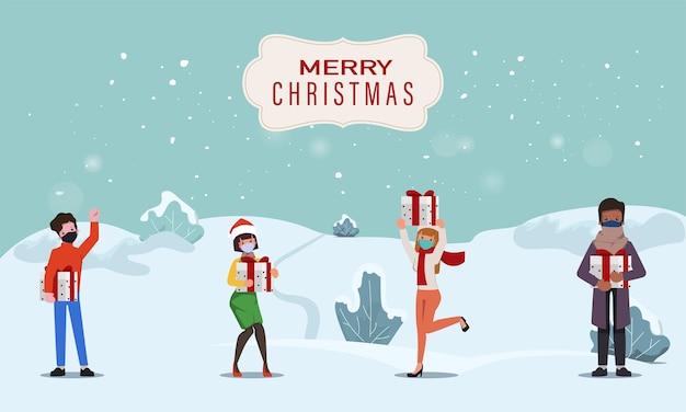 メリークリスマスと新年あけましておめでとうございますで贈り物を祝う人々