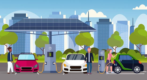 People charging electric cars at electrical charge station renewable eco friendly vehicle clean transport environment care concept modern cityscape background full length