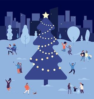 People at christmas tree
