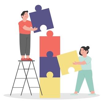 팀 작업의 퍼즐 요소 기호를 연결하는 사람들