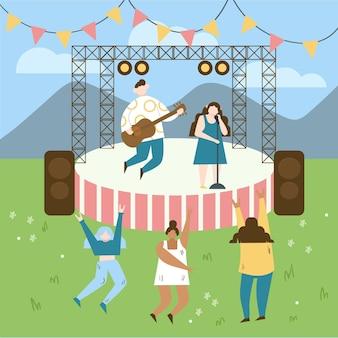 野外コンサートで踊る人々