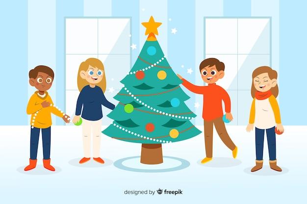 People decorating christmas tree