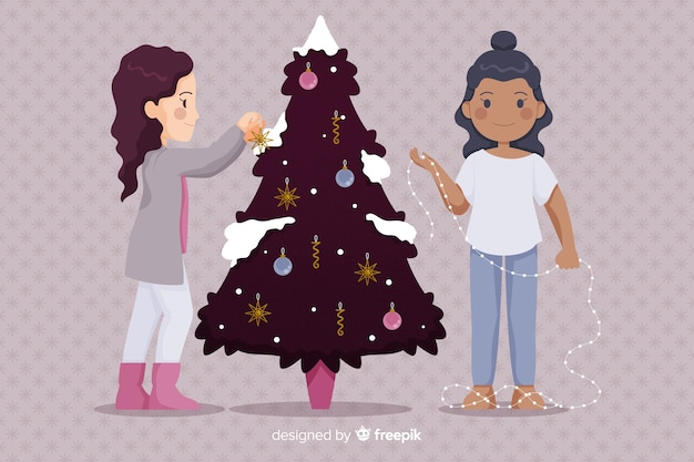 People decorating festive tree