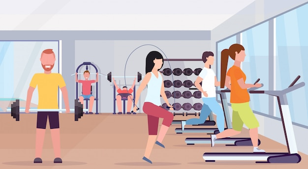 People doing exercises men women working out together training in gym working out healthy lifestyle concept modern health club studio interior horizontal