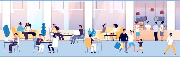 Люди едят за обеденным столом в кафе