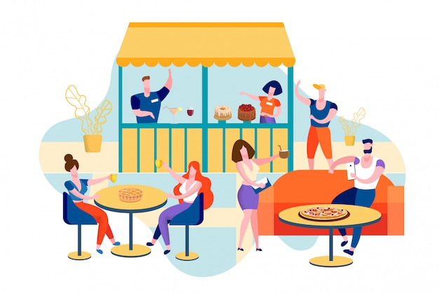 People eating out in public place sitting at table