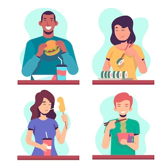 テーブルで食べ物を食べる人