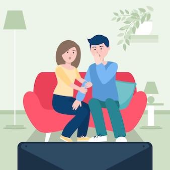 家で映画を楽しむ人