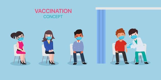 人々はウイルスから保護するために医者と一緒にワクチンを接種します。