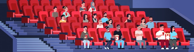 People group watching movie sitting in cinema with popcorn and cola mix race men women having fun laughing at new comedy flat full length horizontal