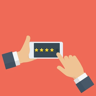 People hand giving rating star on mobile phone