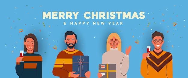 楽しんで、クリスマスと新年を祝う人々。明けましておめでとうとメリークリスマスの休日のコンセプト。