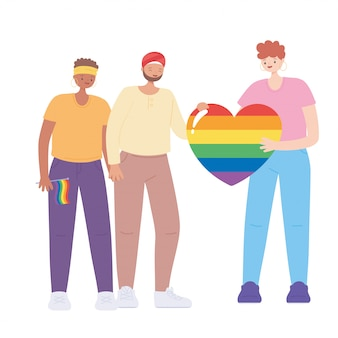 People holding a huge rainbow heart and flag