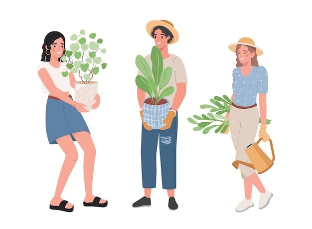 녹색 식물 화분을 들고 사람들