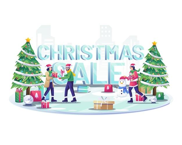 사람들은 아이스 스키를 타고 큰 단어 크리스마스 판매 사인 그림 근처에서 서로에게 선물을 줍니다.