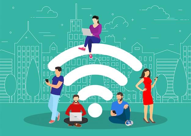 無料のインターネットゾーンで働く人々