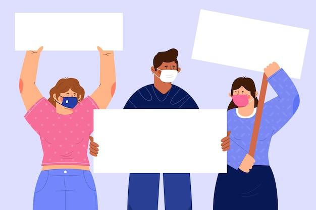 プラカードが描かれた医療用マスクの人々