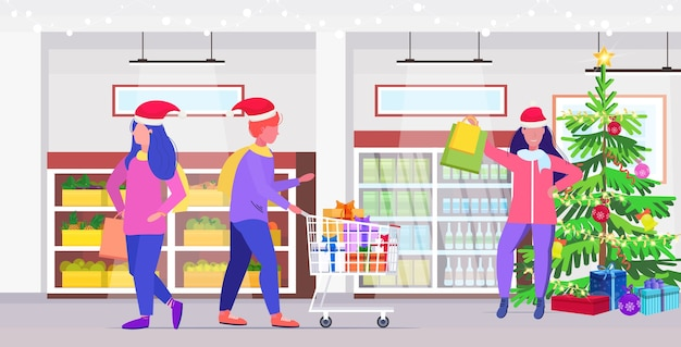 Люди в шапках санта-клауса покупают продукты рождественские праздники празднование шоппинг концепция современный продуктовый рынок интерьер в полный рост