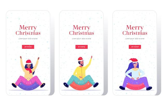 Люди в новогодних шапках катаются на санях по снежной резиновой трубке с рождеством с новым годом зимние каникулы концепция мероприятия экраны смартфонов установить онлайн мобильное приложение