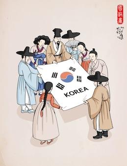 韓国の伝統的な服を着た人々が一緒に紙を持っています。