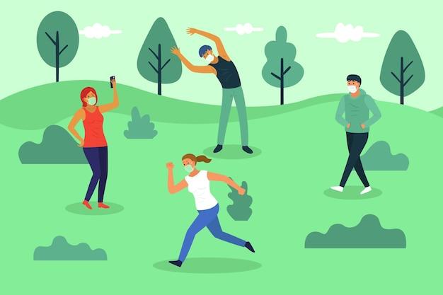 公園で社会的距離を保つ人々