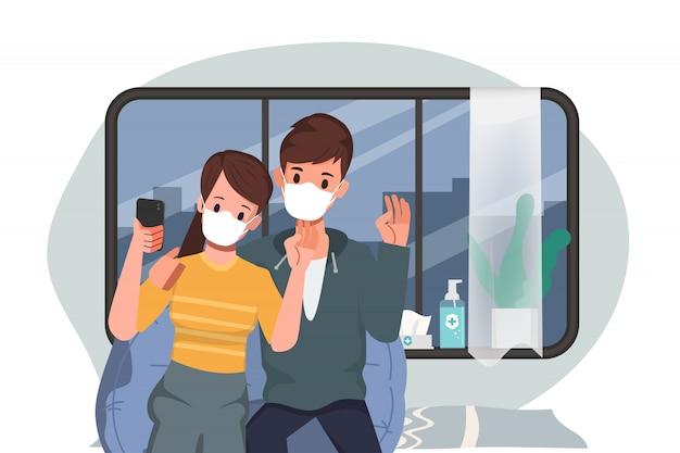 人々は都市に住み、健康を守り、covid-19コロナウイルスの蔓延を防ぎます。カップルは自宅でビデオ会議を続けます。