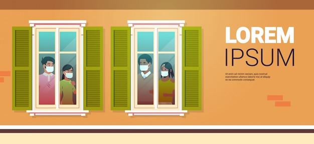 Люди смотрят из квартиры остаются дома концепция изоляции пандемии коронавируса