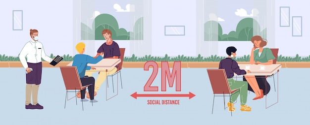 People maintaining safe social distance in cafe