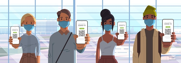 People in masks holding digital immunity passports with qr code on smartphone screens risk free covid-19 pandemic