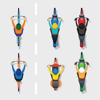 People on motorcycles and bicycles on the road top or above view