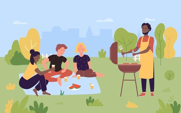 夏の自然の中で野外ピクニックパーティーの人々