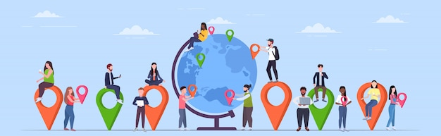 People placing geo tags pointers on globe mix  travelers near earth planet holding location markers gps navigation business position travel concept  full length horizontal