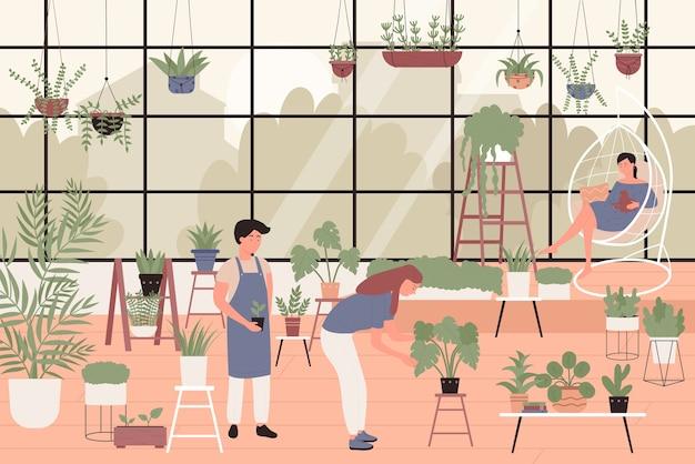 온실 가정 정원에 녹색 식물을 심는 사람들