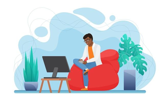 人々は快適なアームチェアに座っている自宅の若い男のゲーマーでビデオゲームコンソールをプレイします
