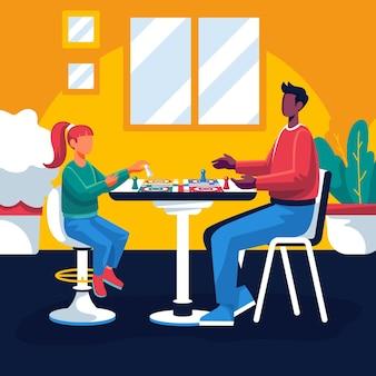 Люди, играющие в людо за столом