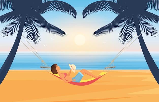 사람들은 해먹에 누워있는 열대 섬의 여름 바다 해변에서 휴식을 취하고 일광욕을합니다.
