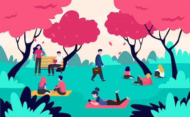 People relaxing in park with blooming pink cherry trees