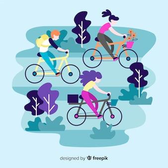 Люди катаются на велосипедах в парке
