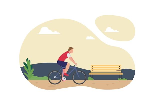 公園で自転車に乗る人。青い自転車と赤いジャージを着ているサイクリスト