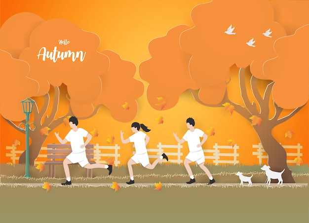 People running on the grass in autumn background.