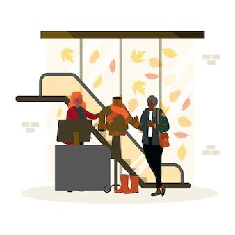 Gente che fa shopping in abiti autunnali