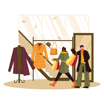秋の服を着て買い物をする人