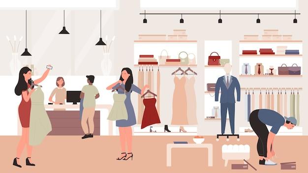 Люди делают покупки в интерьере выставочного зала бутика магазина одежды