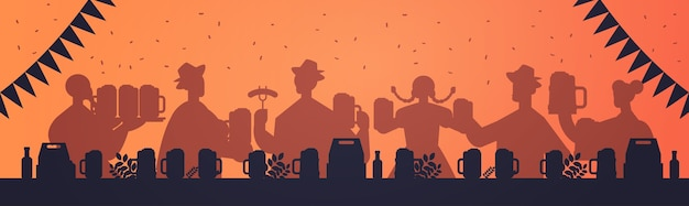 People silhouettes drinking beer and having fun
