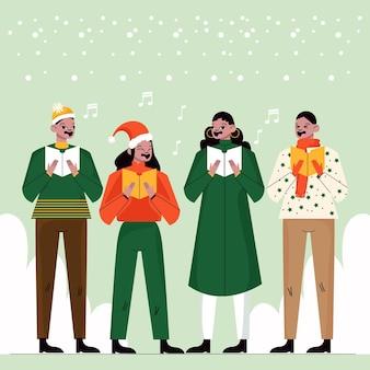 クリスマスの聖歌隊で歌う人々