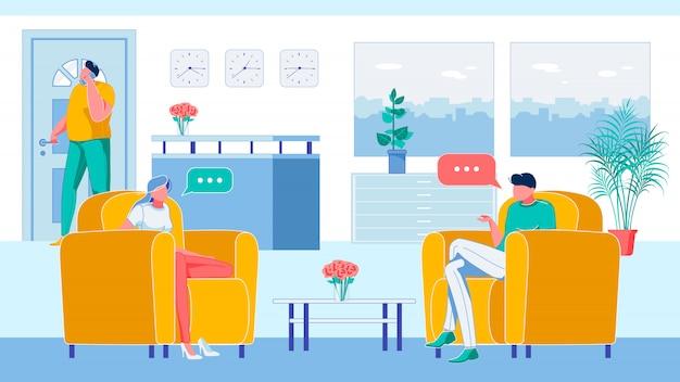 アームチェアに座ってレセプションで話している人々。