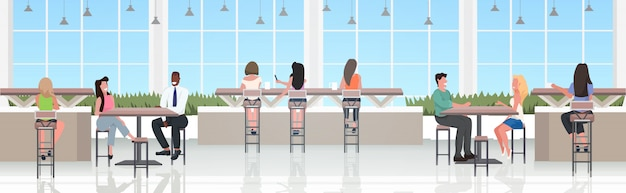 People sitting at cafe tables discussing during meeting modern in restaurant