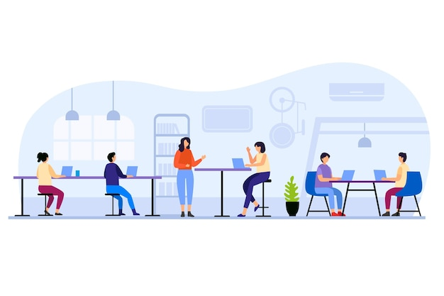 People sitting at tables in coworking space